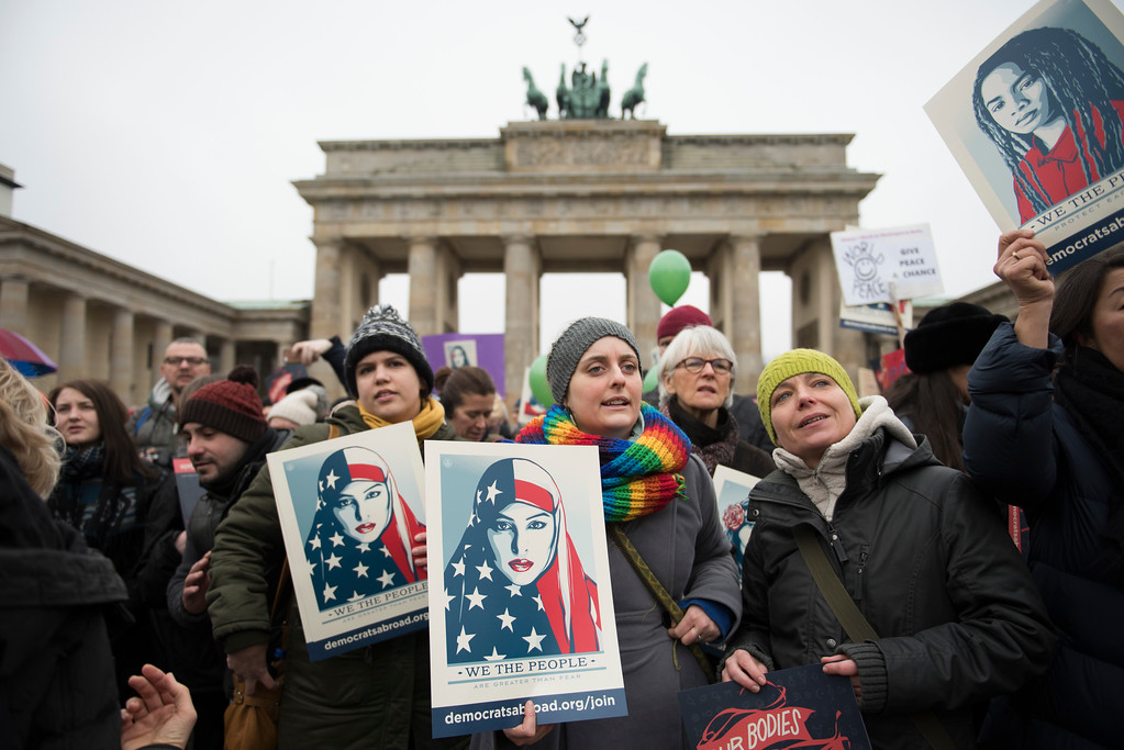 . BERLIN, GERMANY - JANUARY 21: Women and men attend a protest for women\'s rights and freedom in solidarity with the Women\'s March on Washington in front of Brandenburger Tor on January 21, 2017 in Berlin, Germany. The Women\'s  March originated in Washington DC but soon spread to be a global march calling on all concerned citizens to stand up for equality, diversity and inclusion and for Women\'s  rights to be recognised around the world as human rights. Global marches are now being held, on the same day, across seven continents. (Photo by Steffi Loos/Getty Images)