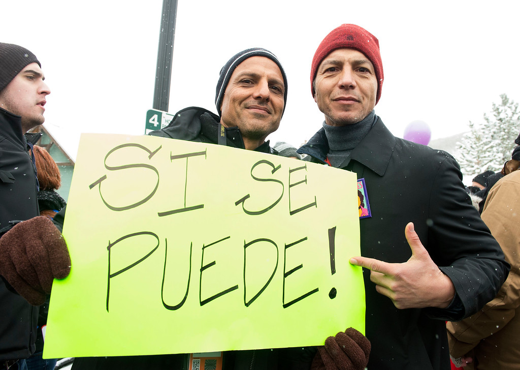 . Benjamin Bratt (R) participates in the Women\'s March on Main Street during the 2017 Sundance Film Festival in Park City, Utah, January 21, 2017. (VALERIE MACON/AFP/Getty Images)