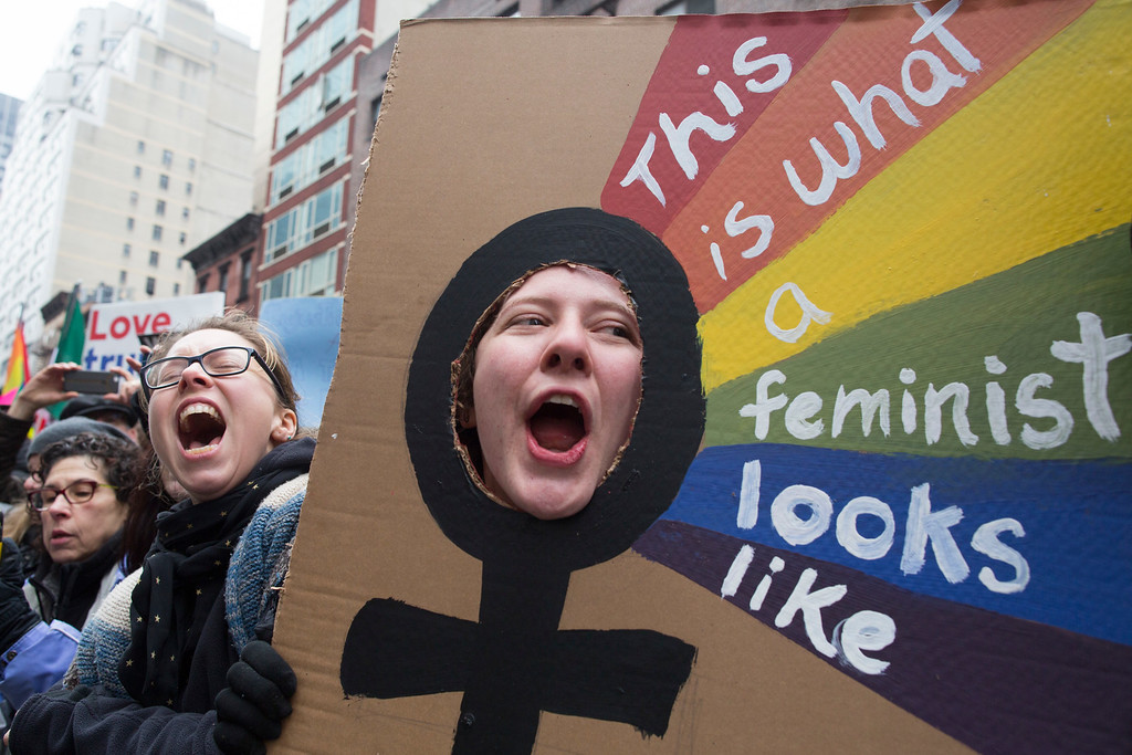 . Kate Weigel, right, of Brewer, Ma., cheers as participants start marching during a women\'s march in New York, Saturday, Jan. 21, 2017. The march is being held in solidarity with similar events taking place in Washington and around the nation. (AP Photo/Mary Altaffer)