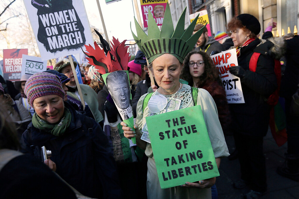 . Demonstrators take part in the Women\'s March on London, following the Inauguration of U.S. President Donald Trump, in London, Saturday Jan. 21, 2016. (AP Photo/Tim Ireland)
