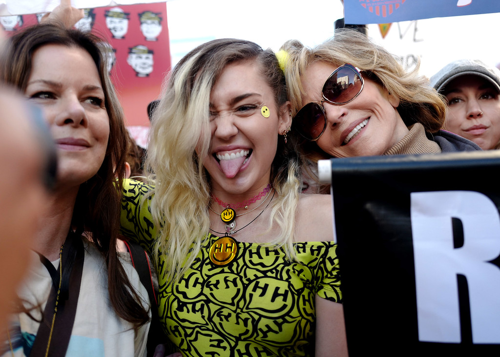 . Singer Miley Cyrus, center, with actress and activist Jane Fonda during Women\'s March Los Angeles, a national movement to unify and empower everyone who stands for women�s rights, human rights, civil liberties, and social justice for all, the march begun at Pershing Square  and marched along Hill and Broadway to City hall on Saturday, Jan. 21, 2017 in Los Angeles. (Photo by Keith Birmingham, Pasadena Star-News/SCNG)
