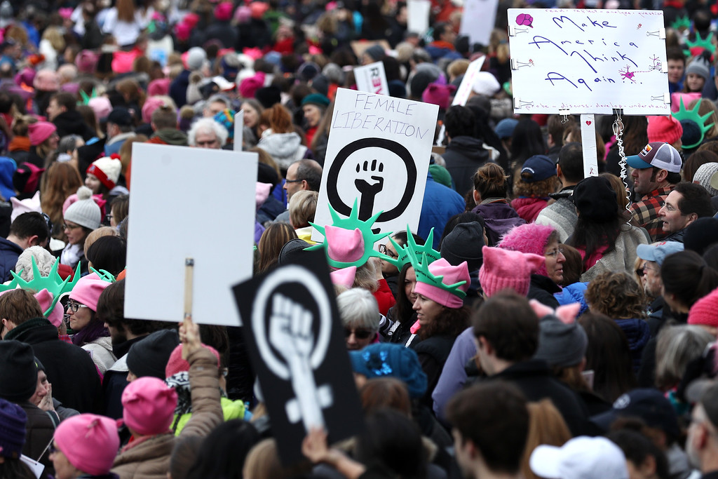 . BOSTON, MA - JANUARY 21: Demonstrators hold signs during the Boston Women\'s March for America on January 21, 2017 in Boston, Massachusetts.Thousands of demonstrators took to the streets in protest after the inauguration of President Donald Trump.(Photo by Maddie Meyer/Getty Images)