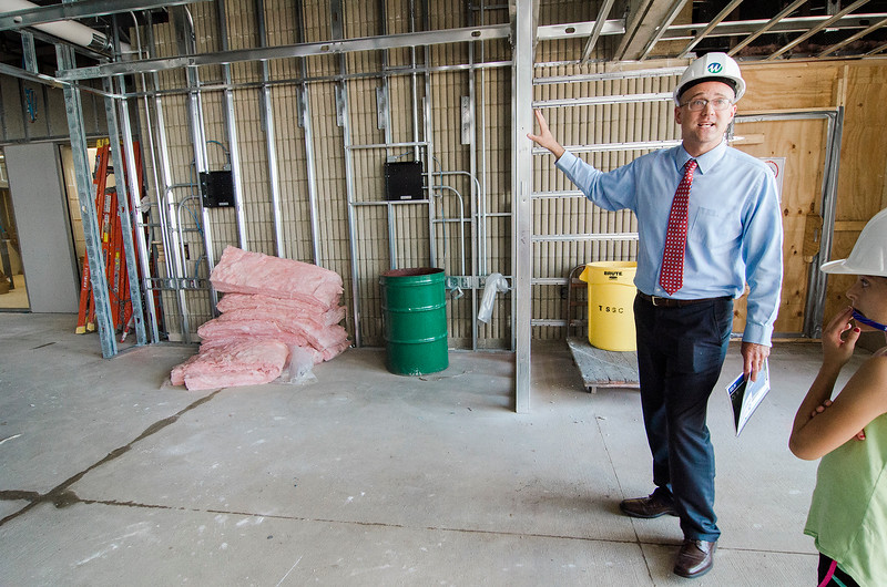 Dean of Students Jason Zelesky leads a tour of the new student center under construction at Mount Wachusett Community College in Gardner on Wednesday, August 19, 2017. SENTINEL & ENTERPRISE / Ashley Green