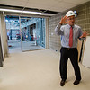 Dean of Students Jason Zelesky shows off plans for the new student center under construction at Mount Wachusett Community College in Gardner on Wednesday, August 19, 2017. SENTINEL & ENTERPRISE / Ashley Green