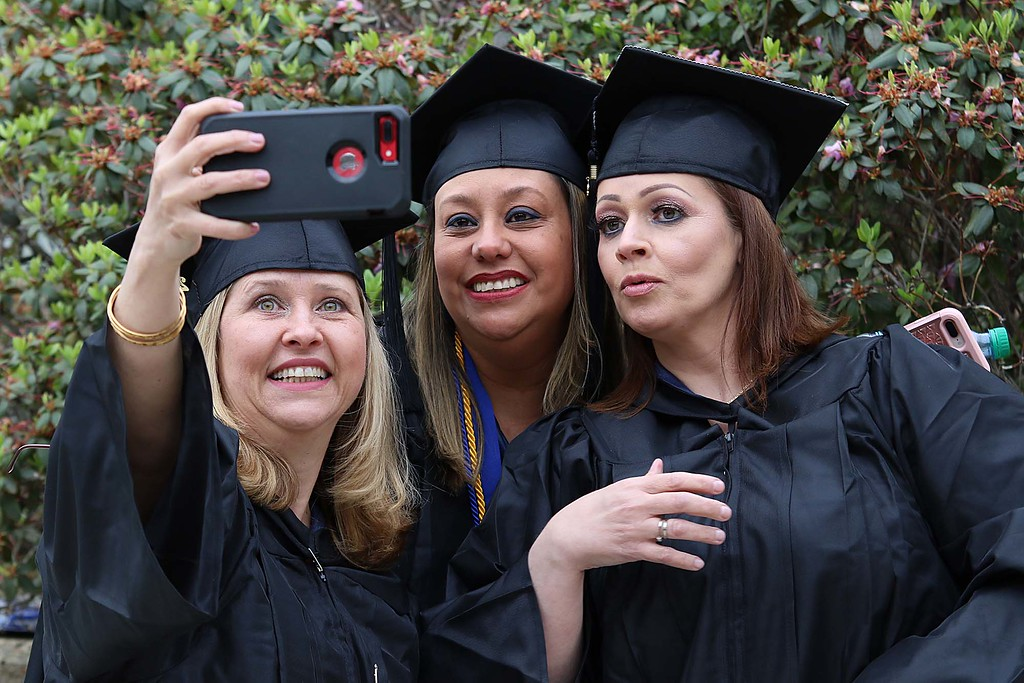 . Mount Wachusett Community College held its fifty-third commencement on Wednesday, May 16, 2018. Taking a picture just before the graduation started is, from left Rosie Bonicenha from Acton, Edna Lopez from Clinton and Paola Molina from Marlboro. SENTINEL & ENTERPRISE/JOHN LOVE
