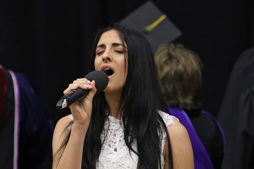 . Mount Wachusett Community College held its fifty-third commencement on Wednesday, May 16, 2018. Whitney Doucet sings the national anthem to start the ceremony.  SENTINEL & ENTERPRISE/JOHN LOVE