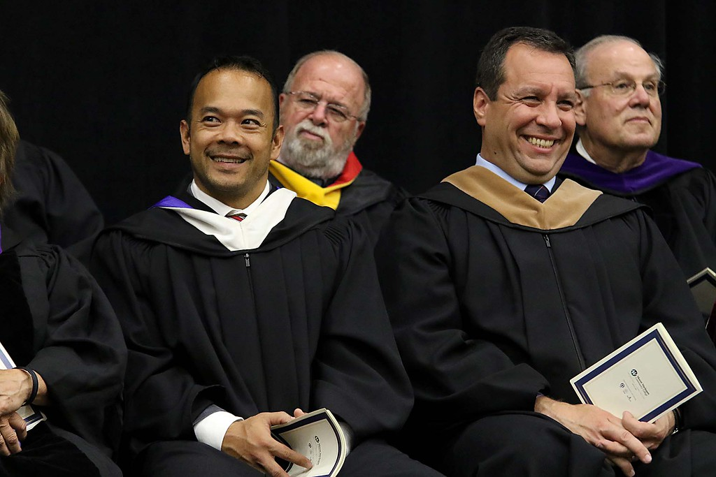 . Mount Wachusett Community College held its fifty-third commencement on Wednesday, May 16, 2018. Senator Dean Tran and Gardner Mayor Mark Hawke laugh at one of Gov. Charlie Bakers jokes as he addresses the graduates at the ceremony. SENTINEL & ENTERPRISE/JOHN LOVE