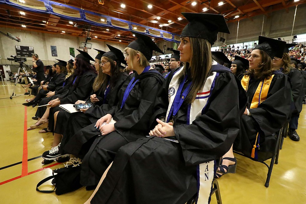 . Mount Wachusett Community College held its fifty-third commencement on Wednesday, May 16, 2018. Graduate Army veteran Staff Sgt. Jacqueline Ann Morse from Baldwinville, on end, listens to the speakers with fellow graduates during the ceremony. SENTINEL & ENTERPRISE/JOHN LOVE