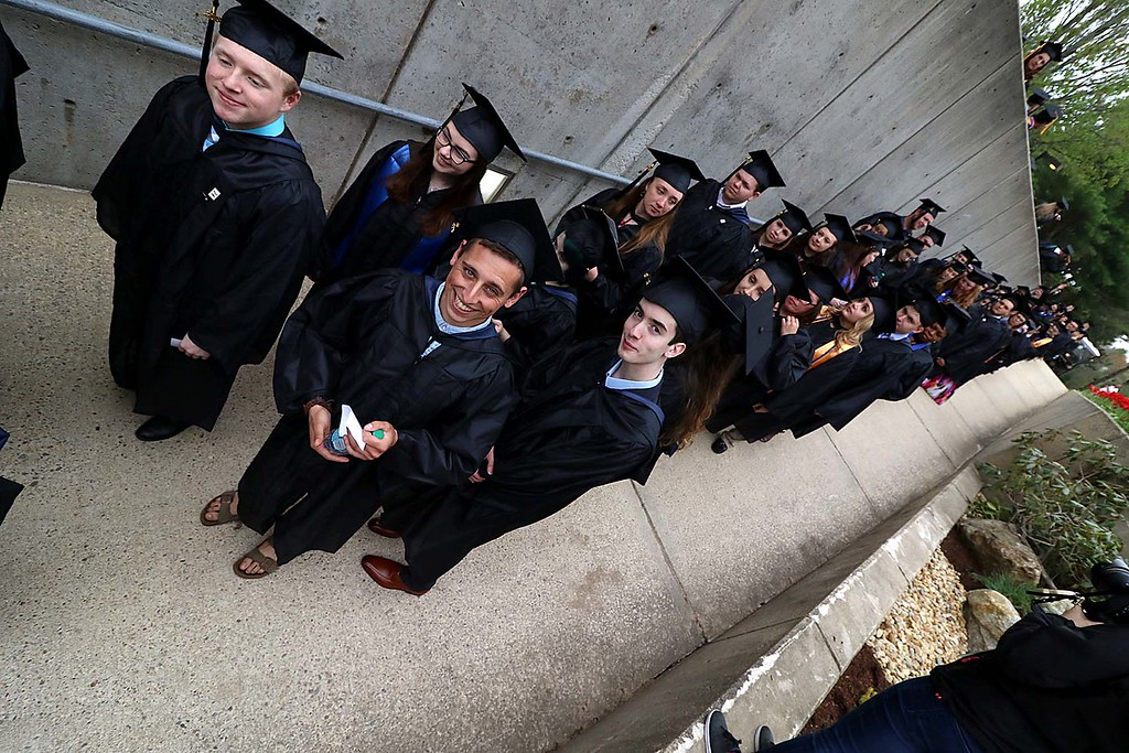 . Mount Wachusett Community College held its fifty-third commencement on Wednesday, May 16, 2018. Graduates parade into the school as the ceremony started. SENTINEL & ENTERPRISE/JOHN LOVE