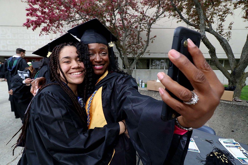 . Mount Wachusett Community College held its fifty-third commencement on Wednesday, May 16, 2018. Taking a picture just before the graduation ceremony started is Sadie Clark from Gardner and Naomi Tucker from Leominster. SENTINEL & ENTERPRISE/JOHN LOVE