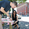 Students Arren Walsh, 18, and Lauren Belanger, 28, work on the new seats that were being put in on Main Street in Fitchburg by Mount Wachusett Community College's First Year Experience Class (FYE). SENTINEL & ENTERPRISE/JOHN LOVE