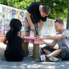 Students Lauren Belanger, 28, Arren Walsh, 18, and David Cormier Jr., 24, work on putting together the new seats that were being put in on Main Street in Fitchburg by Mount Wachusett Community College's First Year Experience Class (FYE). SENTINEL & ENTERPRISE/JOHN LOVE