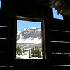 LOOKING OUT THE WINDOW OF AN OLD MINE SHACK AT THE TOMBOY MINE, HIGH ABOVE TELLURIDE, COLORADO.