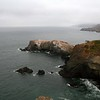 LOOKING DOWN ON BIRD ISLAND & THE PACIFIC OCEAN FROM THE CLIFFS OF THE  GOLDEN GATE NATIONAL RECREATION AREA IN MARIN COUNTY, CALIFORNIA.