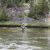 A FLY FISHERMAN IN THE FIREHOLE RIVER IN YELLOWSTONE.