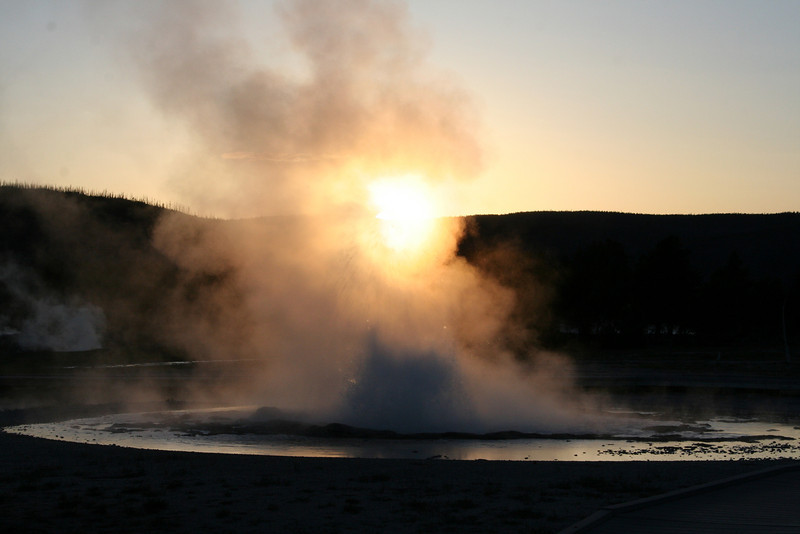 SOLITARY GEYSER ERUPTS INTO THE SUNRISE.