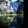A VIEW OF YOSEMITE FALLS FROM THE MERCED RIVER.