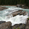 NATURAL BRIDGE WATERFALL IN YOHO NATIONAL PARK