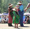 A FAMILY DISCUSSION AT THE TELLURIDE COLORADO BLUEGRASS FESTIVAL.