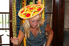 VICKY IN A PIZZA HAT POSE.