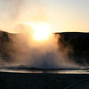 SUNSET THROUGH A YELLOWSTONE GEYSER