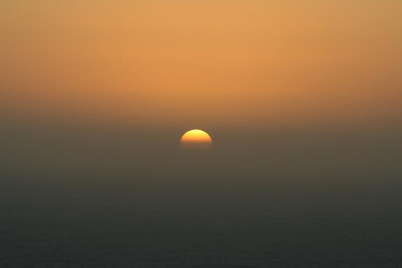 THE SETTING SUN AT MUIR BEACH CALIFORNIA