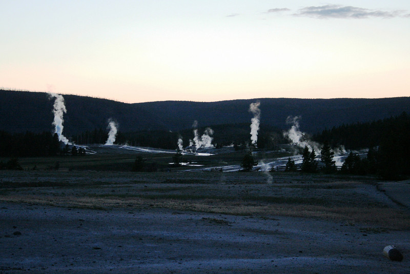 TWILIGHT NEAR OLD FAITHFUL IN YELLOWSTONE