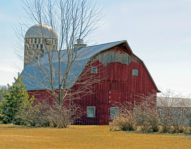 RED BARN WITH MISSING PAINT