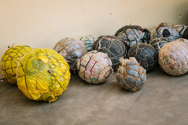 Handmade balls from trash and string.  We commonly trade one of our soccer balls for these handmade balls.