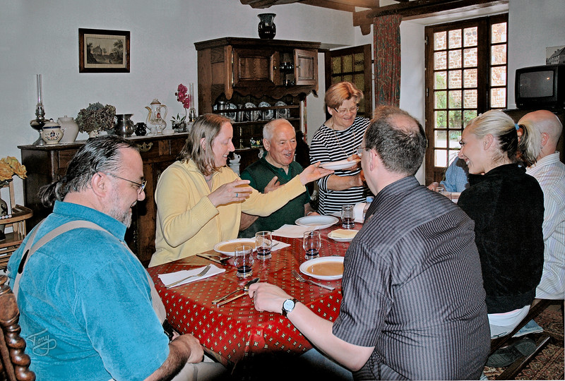 Chez DesGranges 2006 - clockwise from left - moi, Judy, René et Simone, (our hosts at the gîte,) Papa, Bobby, Jessie, and Father Mark
