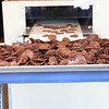 'cow chips' in the making.. chocolate covered Potato chips