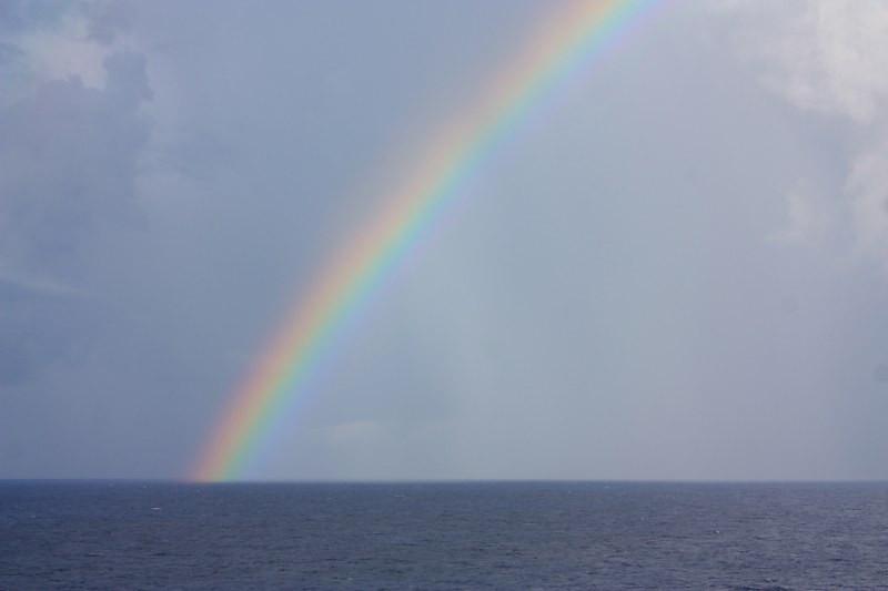 a rain squall produced this rainbow