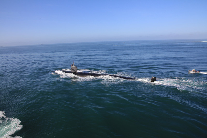 US Navy Sub with Seal Team boat following as it passes our ship entering San Diego Bay