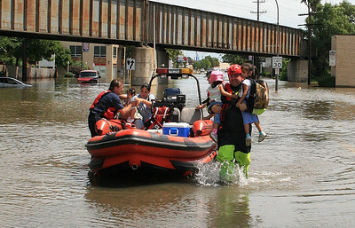 Park Ridge FireFighters Rescue A Family From A Flooded House In Westchester Illinois