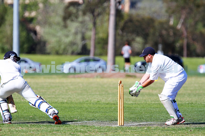 5-10-14. Maccabi AJAX Cricket First XI  5/170 def Power House all out 120 at David Mandie Oval. Mark Shnider 102 not out. Yossi Herbst 5/33. Mark Shneider attempts a stumping. Photo: Peter Haskin