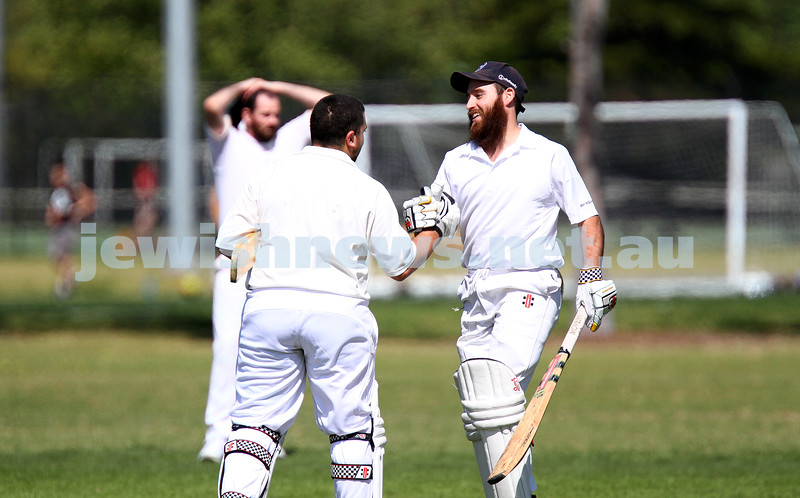 5-10-14. Maccabi AJAX Cricket First XI  5/170 def Power House all out 120 at David Mandie Oval. Mark Shnider 102 not out. Yossi Herbst 5/33. Eli Adelist congratulates Mark Shnider. Photo: Peter Haskin