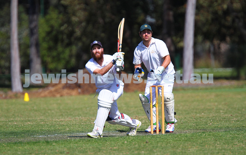 5-10-14. Maccabi AJAX Cricket First XI  5/170 def Power House all out 120 at David Mandie Oval. Mark Shnider 102 not out. Yossi Herbst 5/33. Eli Adelist watching as his shot sails over the boundary for 6. Photo: Peter Haskin