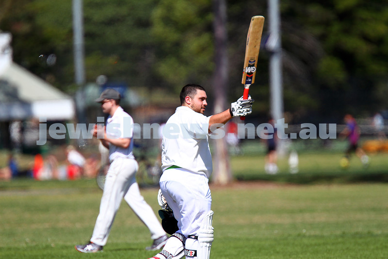 5-10-14. Maccabi AJAX Cricket First XI  5/170 def Power House all out 120 at David Mandie Oval. Mark Shnider 102 not out. Yossi Herbst 5/33. Mark Shnider raises his bat after scoring 100. Photo: Peter Haskin