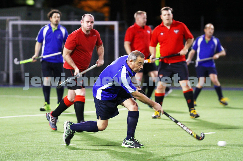 16-9-15. Maccabi Hockey Veterens lost 1 - 2 to Essendon in the grand final. Harley Cohen playing the ball forward. Photo: Peter Haskin