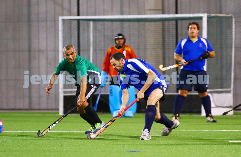 29-2-16. Maccabi Hockey veterans defeated Power House 3-2 in the Summer season grand final. David Birnbaum clears the ball out of defense. Photo: Peter Haskin