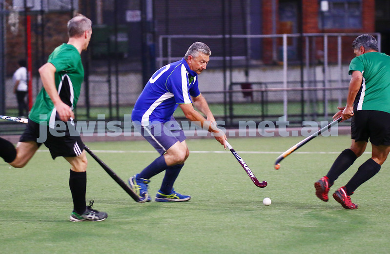 29-2-16. Maccabi Hockey veterans defeated Power House 3-2 in the Summer season grand final. Wayne Levy pushes the ball toward goal. Photo: Peter Haskin
