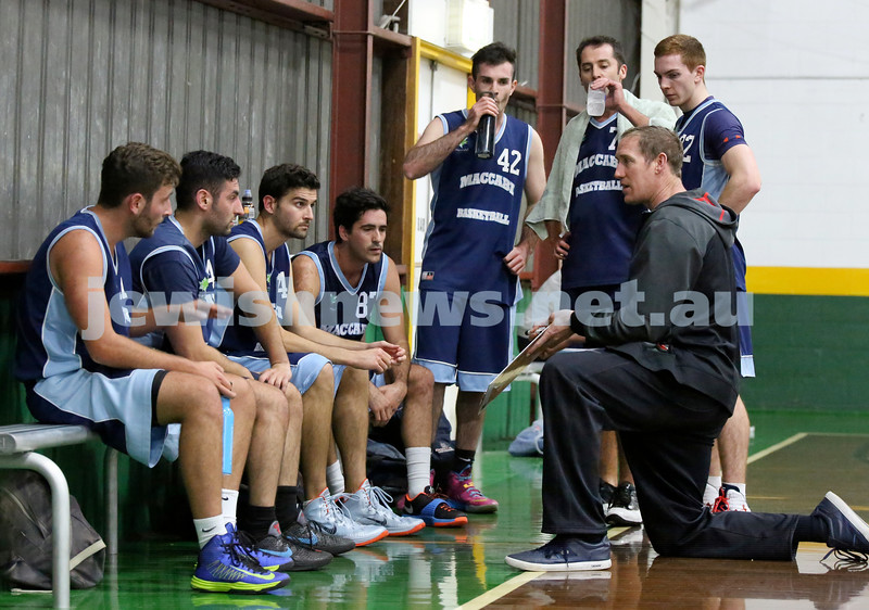 Basketball - Maccabi Kings vs Throwback Cheetahs. Kings lost 62 -32. Coach Ben Knight talks to the team during timeout.