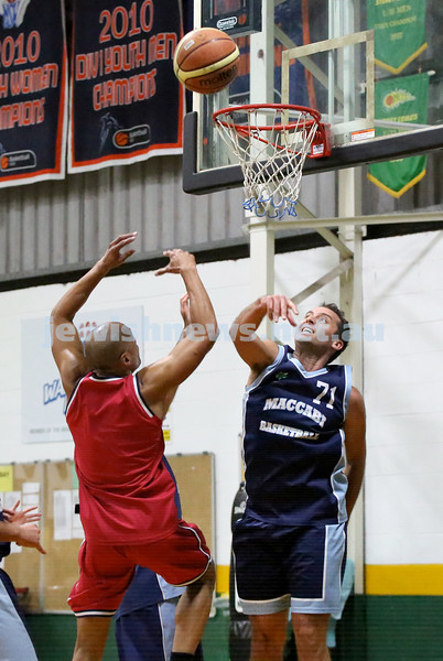 Basketball - Maccabi Kings vs Throwback Cheetahs. Kings lost 62 -32. Daniel Kresner attempts to deflect the ball.