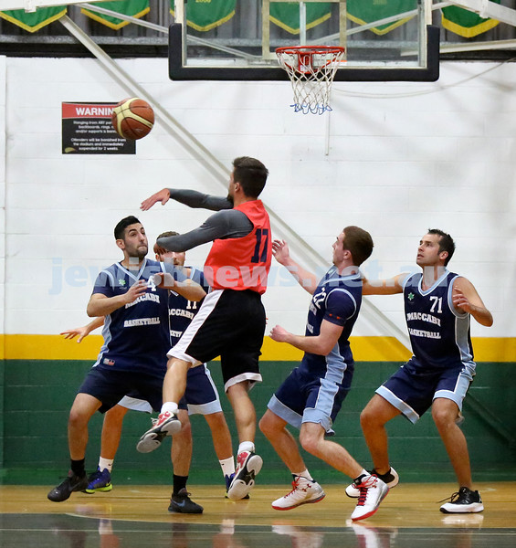 Basketball - Maccabi Kings vs Throwback Cheetahs. Kings lost 62 -32. Kings in defense mode. L-R Michael Wagenheim, Desi Kohn, Zac Ehrenfeld, Daniel Kresner.