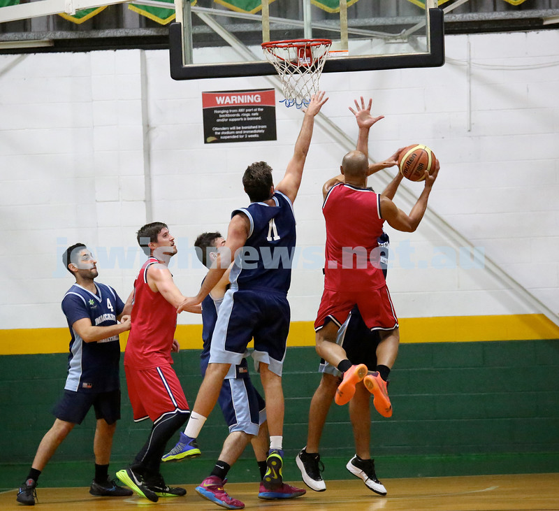 Basketball - Maccabi Kings vs Throwback Cheetahs. Kings lost 62 -32. Desi Kohn in the air attempting to block a shot.