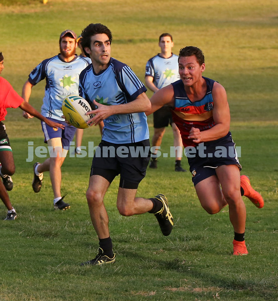 Touch Football. Maccabi Mac Touch vs Rat Pack at Queens Park. David Weiner being chased by an opponent player.