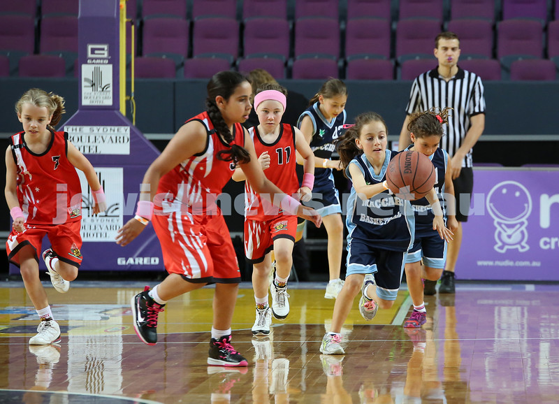 Maccabi U10 Mercury vs Inner City at The Sydney Entertainment Centre. Maccabi lost 36-4. Lila Greenberg makes a charge towards the basket followed closely by Claudia Lees & Ella Hart.