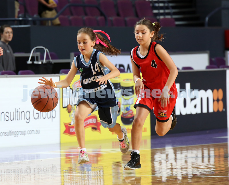 Maccabi U10 Mercury vs Inner City at The Sydney Entertainment Centre. Maccabi lost 36-4. Lila Greenberg races past a an opposition player.