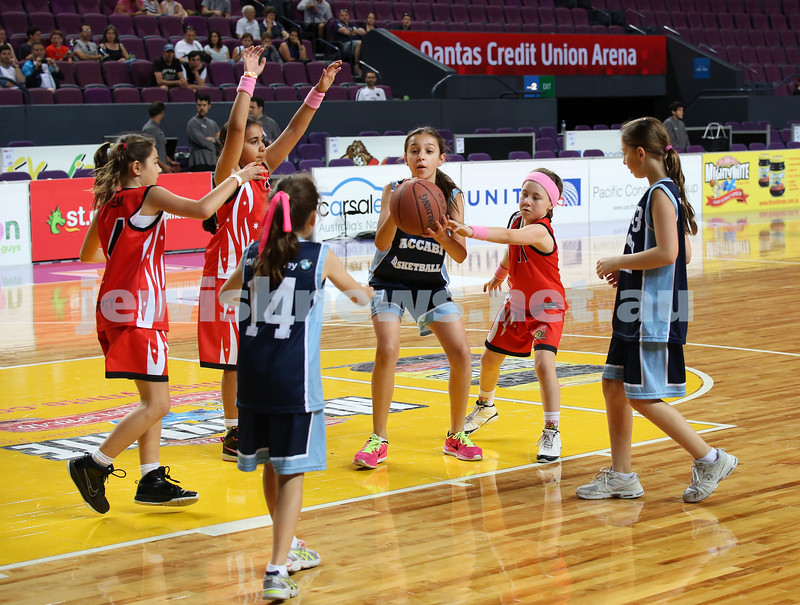 Maccabi U10 Mercury vs Inner City at The Sydney Entertainment Centre. Maccabi lost 36-4. Claudia Lees about to pass the ball to Lila Greenberg (L) as Lily Elias looks on.