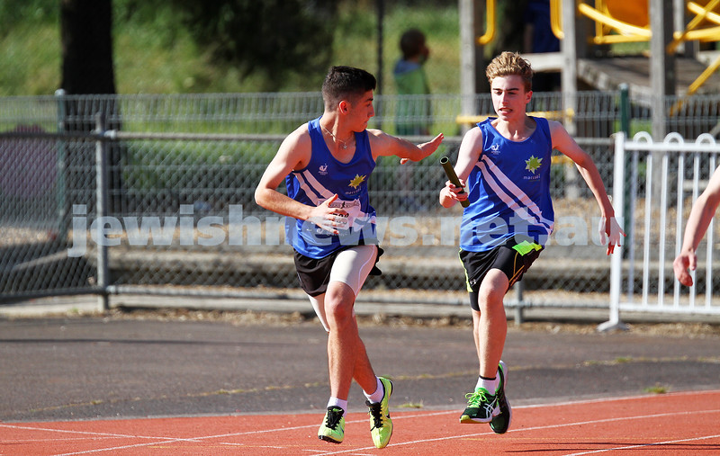 25-10-14. Maccabi Athletics. Athletics Victoria Shield, Knox.U16 4x100. Gideon Goldberg hands off baton to Asher Marks.  Photo: Peter Haskin
